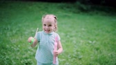 キッド : Child Having Fun In Nature. Girl Making Soap Bubbles Outdoors 動画素材
