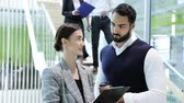 Business People. Man And Woman Talking At Work In Office Stock Footage