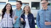 mulher bonita : Happy Young People Walking On Street And Talking Stock Footage