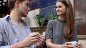 даты : Couple In Cafe. Young People Drinking Coffee And Communicating