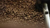 боб : Coffee Production. Brown Beans Roasting In Machine Closeup