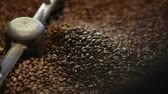 coffee machine : Coffee Production. Brown Beans Roasting In Machine Closeup