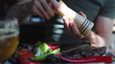 fűszerezés : Food Closeup. Man Hand Seasoning Steak Meat With Grounded Pepper