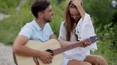 Romantic Date, Nature, Couple Kissing And Playing In Guitar. Man And Woman In Love Spending Time Together Together