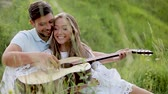 Couple In Love In Nature, Man Playing Woman Playing On Guitar. Smiling Woman Learning To Play On Instrument