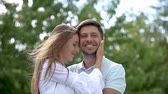 felicidade : Romantic Woman Kissing Man In Cheek In Nature. Happy Couple In Love Hugging Outdoors Stock Footage
