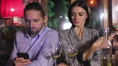 entediado : Communication Problem. People Using Phone On Date At Restaurant Stock Footage