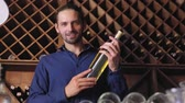 personalizado : Handsome Man Holding Bottle Of Wine In Cellar Winery