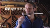 выборе : Wine Tasting. Man Smelling Drinking Red Wine At Winery Cellar Стоковые видеозаписи
