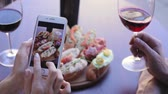 aperitivo : Food And Drink Photo. Woman Looking At Pictures On Phone Screen