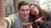 fotky : Happy Couple Making Selfie Photo And Having Fun At Street Dostupné videozáznamy