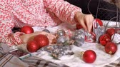 preparation : Close up of girl decorating Christmas tree