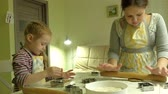 kaka : Two kids kneading the dough for make cookies together