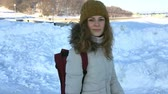 sity : FOLLOW Young female hiking with a backpack in beautiful winter sity, Stock Footage