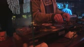 jokey : cool dj behind the turntables performing in a bar