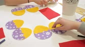 moda : Girls at the lesson with the teacher sew a soft toy with their own hands
