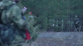 munice : Soldiers in camouflage with combat weapons and in the US in the forest, military concept