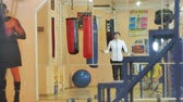 kickboxer : woman training in the gym, working with a rope, outside a healthy body fitness kickboxer series