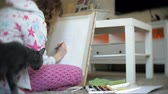 ressam : Young woman painting artist at home sitting on the floor creative painting Stok Video
