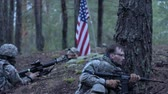 конфликт : Soldiers in camouflage with combat weapons and in the US in the forest, military concept