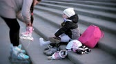 inline : little girl dresses skating roller. Concept: sports, lifestyle, health.