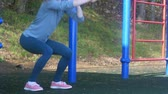 spor salonu : young fitness woman doing exercises on the gym in an outdoor park