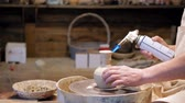 molding : Potter at work. Potter making ceramic pot on the pottery wheel Stock Footage