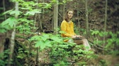 notebooklar : Girl with Laptop, Sitting On a Rock, In the Forest Stok Video