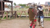 lovagi torna : Knights in steel armor and chain mail helmets fighting at medieval tournament