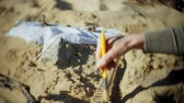 szkielet : The woman is engaged in excavating bones in the sand, Skeleton and archaeological tools. Wideo