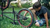 szivacs : The boy washes his bicycle with water and foam