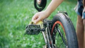 bisiklete binme : The boy washes his  bicycle with water and foam