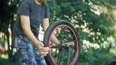 jazda na rowerze : The boy washes his BMX bicycle with water and foam