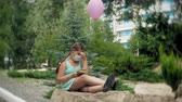 respiração : Cute girl in a respirator reading a book in the park Stock Footage