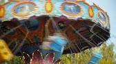 carnívoro : Teenage girls on a chain swing carousel