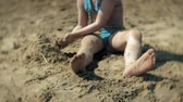 activity : baby girl playing on the beach with sand Stock Footage