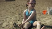 recreativo : baby girl playing on the beach with sand Stock Footage