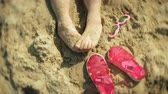 group of children : feet sandals glasses beach. close-up