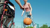 atma : Disabled man plays basketball from his wheelchair With a woman, On open air, Make an effort when playing