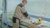 lumber industry : male worker gluing wooden blanks for a door. production of interior doors of wood Stock Footage