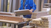 lumber industry : the process of collecting doors from wooden blanks, the production of rustic interior doors Stock Footage