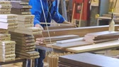 the process of collecting doors from wooden blanks, the production of rustic interior doors Stock Footage