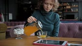 distante : Attractive young woman with tablet in cafe, freelancer concept
