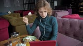 stylus : Attractive young woman with tablet in cafe, freelancer concept