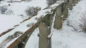 old time : old railway aqueduct, stone bridge. snow, winter time. aerial, copter shoot
