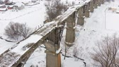 památka : old railway aqueduct, stone bridge. snow, winter time. aerial, copter shoot