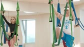 hamak : Aerial, antigravity yoga in gym. Group of people swinging in the hammocks