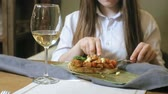 white wine dish : Beautiful blonde woman eating and drinking in restaurant, lunch break Stock Footage