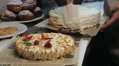 パン屋 : The concept of cooking. Professional pastry chef makes a delicious cake, closeup 動画素材