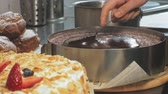スプレッド : The concept of cooking. Professional pastry chef makes a delicious cake, closeup 動画素材